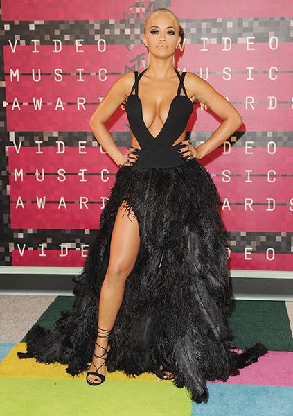 Fashionista Rita Ora is never one to be outdone on the red carpet. Her super sexy black strappy top and feathered bottom dress were a head turner at the 2015 Video Music Awards.