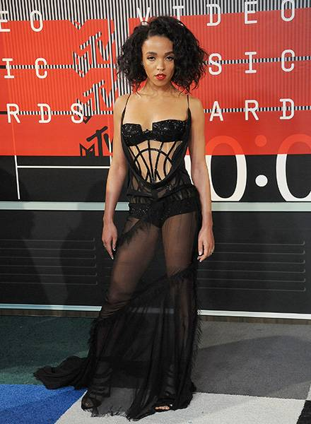 Brit singer/songwriter FKA Twigs wowed on the 2015 VMA red carpet donning a see-through black gown.