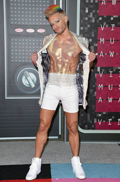 """We're pretty sure the word """"overkill"""" isn't in reality star Frankie Grande's vocabulary, thanks to the white and silver short-suit he rocked on the 2015 Video Music Awards red carpet (sans shirt, obvz)."""