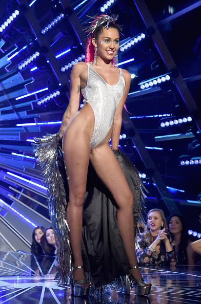 Miley Cyrus never met a slit she didn't like, and the up-to-there cut of her sparkly silver bodysuit on stage at the 2015 VMAs is solid proof.
