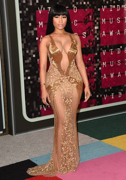 Goddess Nicki Minaj blessed the 2015 VMA red carpet in a beaded, gold-toned, barely-there dress that was an absolute showstopper.
