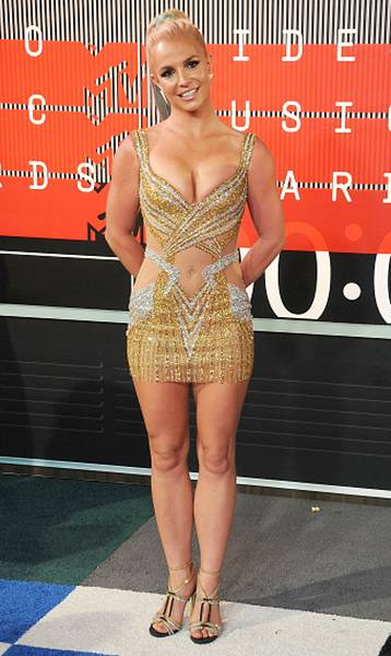 Britney Spears bares an itty-bitty bit of belly in a tight, silver and gold mini dress with perfectly placed cut-outs on the 2015 Video Music Awards red carpet.