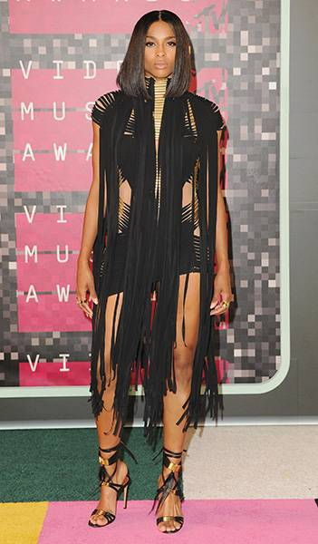 During the 2015 Video Music Awards red carpet, Ciara rocked a gorgeous black tasseled dress with matching heels. Can you say hawt?!