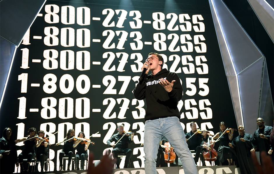 """In one of the most powerful moments of the night, Logic was joined by 50 suicide attempt and loss survivors for his 2017 VMA performance of his song titled for the suicide hotline, """"1-800-273-8255."""""""