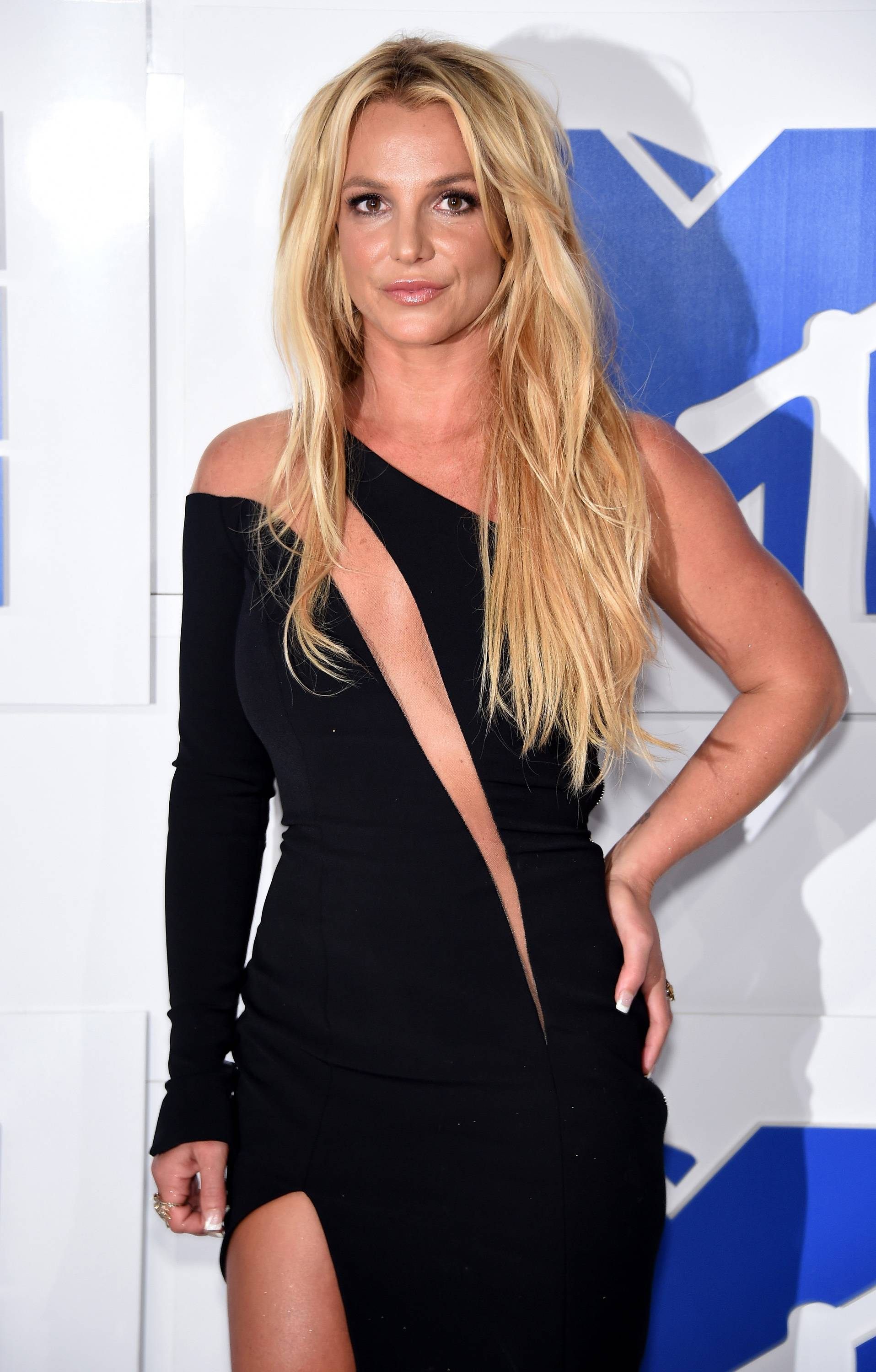 Britney Spears turns heads in her cut-out asymmetrical black dress on the 2016 VMA Red Carpet.