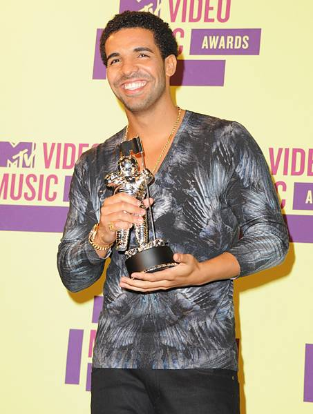 """""""Hell Yeah F***ing Right"""" is right! Drake is all smiles as he displays his Moonman for Best Hip Hop Video in 2012."""