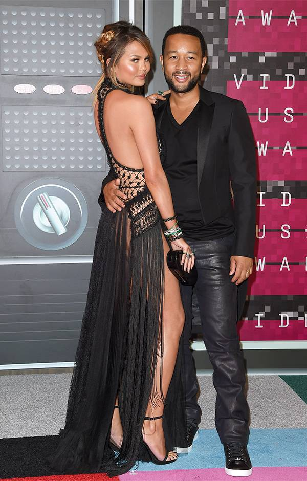 Power couple Chrissy Tiegen and John Legend matched in all black everything on the 2015 VMAs red carpet.