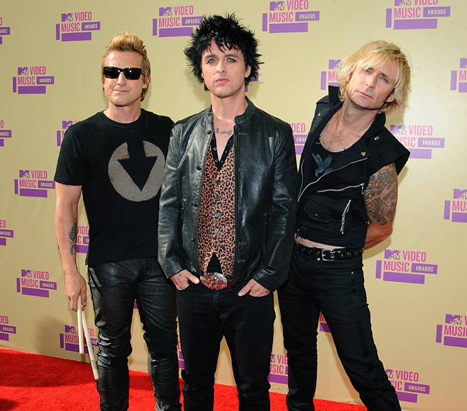 The gents of Green Day keep it casual in dark hues on the 2012 VMA red carpet.