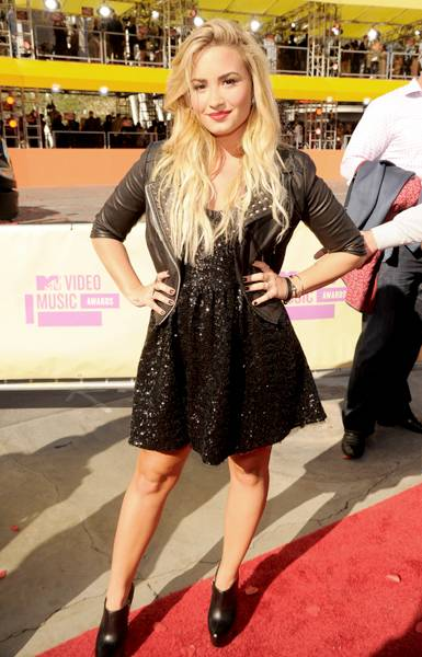 Demi struts from concert to carpet after performing 'Give Your Heart A Break' at the 2012 VMA Pre-Show.