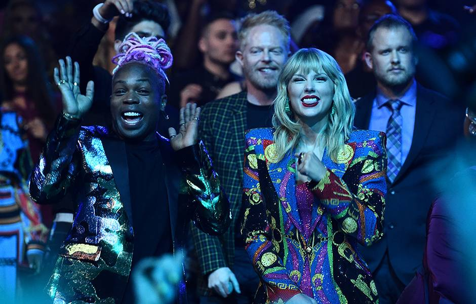 Taylor Swift enjoys the show with her collaborator Todrick Hall at the 2019 VMAs.