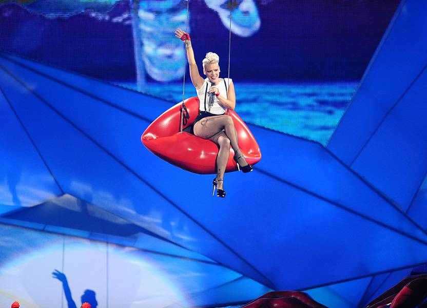 """LIP SERVICE. P!nk dips in from the ceiling for a puckered performance of """"Blow Me (One Last Kiss)"""" on the 2012 VMA stage."""