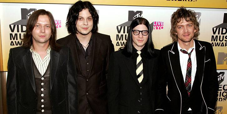 Jack White takes a break from red and white as he joins fellow black-clad Raconteurs Patrick Keeler, Little Jack Lawrence and Brendan Benson at the 2006 VMAs.