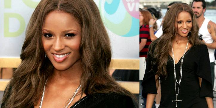 """Ciara's sexy smile keeps her heavy black dress and oversized silver and gold cross from looking too """"nun-chic"""" at the 2005 VMAs."""