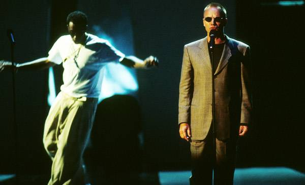 """P. Diddy and Sting perform """"I'll Be Missing You"""" at the 1997 MTV Video Music Awards in New York City."""