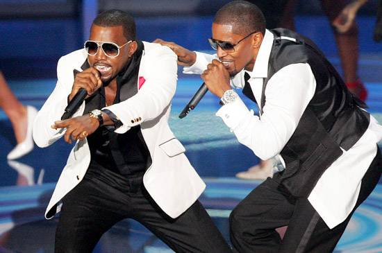 """Kanye West and Jamie Foxx perform """"Gold Digger"""" at the 2005 MTV Video Music Awards in Miami."""