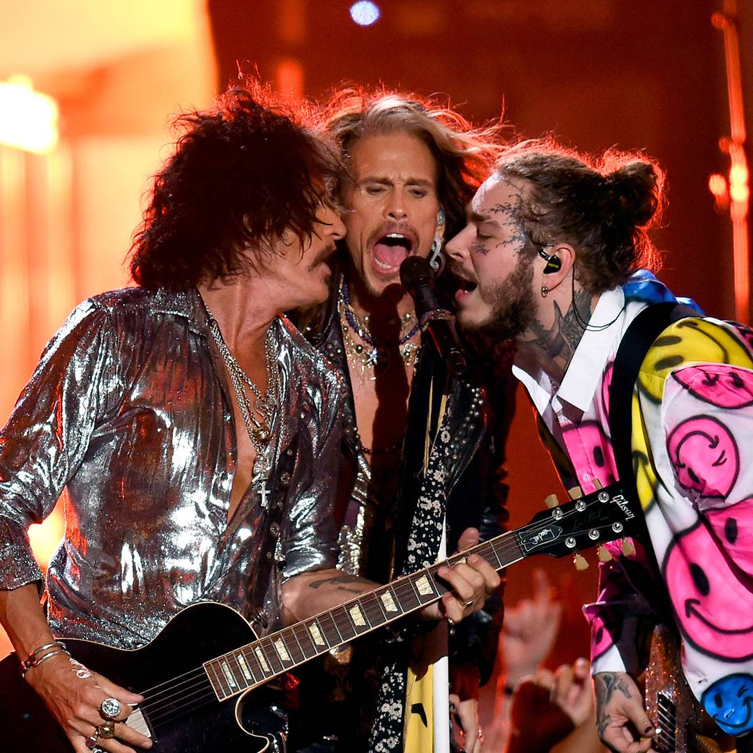 Post Malone rocks out with Steven Tyler and Joe Perry of Aerosmith.
