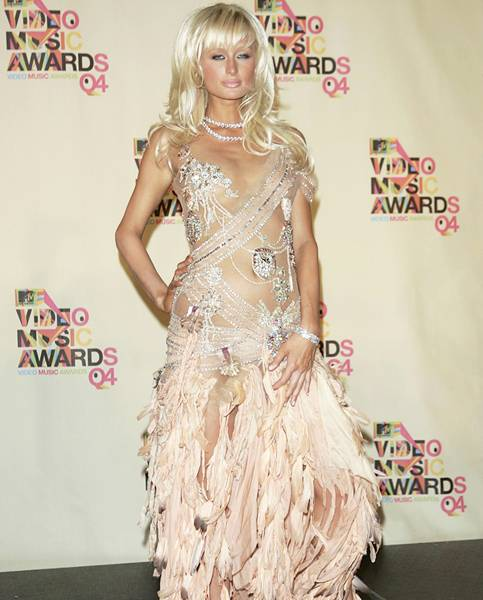 08.29.2004, Miami, FL: Just when you thought you'd seen enough of Paris Hilton, she appears at the 2004 VMAs barely covered in sequins and feathers.