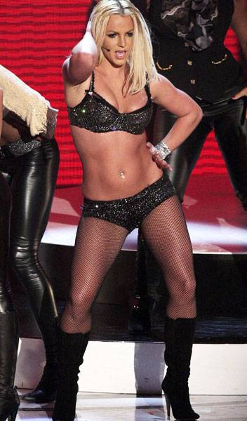 09.09.2007, Las Vegas, NV: Somehow we don't think Britney Spears was talking about clothes as she strutted around the stage singing 'Gimme More' in this lingerie inspired outfit.