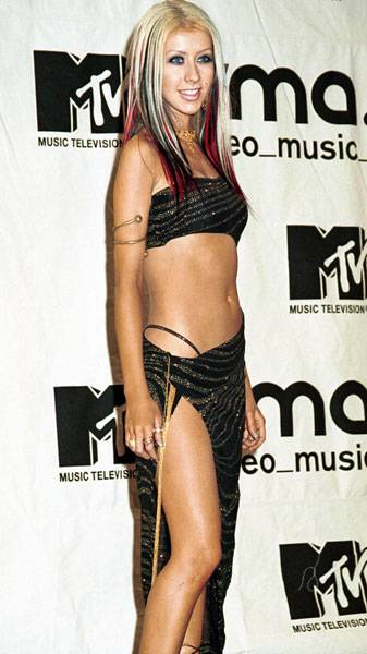 09.07.2000, New York City, NY: Christina Aguilera unleashes her inner belly dancer, baring nearly all in a glittery midriffer and a skin-tillating wrap skirt.