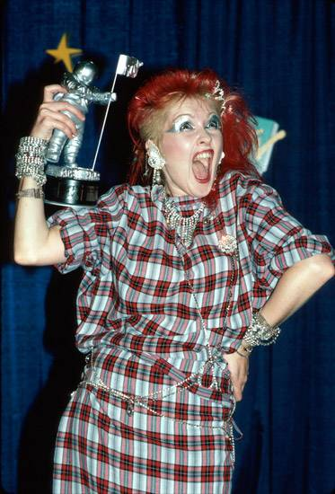 Cyndi Lauper does her best imitation of what the Moonman looks like without his helmet on at the 1984 MTV Video Music Awards.