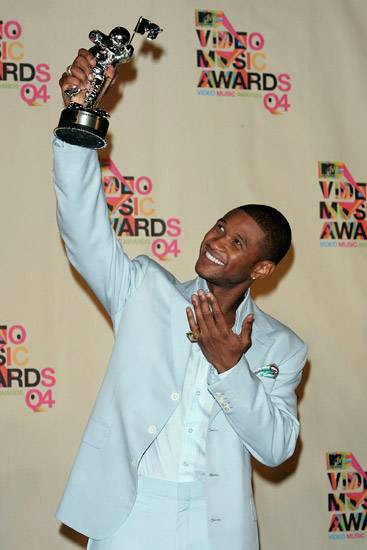 After the 2004 MTV Video Music Awards, Usher gazes lovingly up at his Moonman prize.