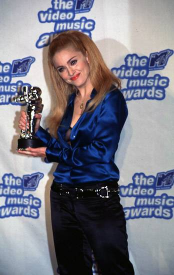 Madonna and her Moonman smile at photographers, ready for their close-up, at the 1995 MTV Video Music Awards.