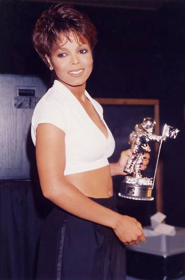 After the 1995 MTV Video Music Awards, Janet Jackson takes a moment to think about where she will display her seventh Moonman.