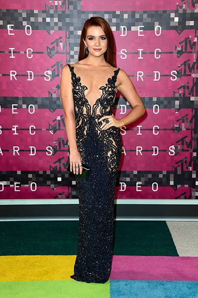 In a glistening gown, 'Faking It' star Katie Stevens looks old Hollywood glam on the red carpet at the 2015 show.