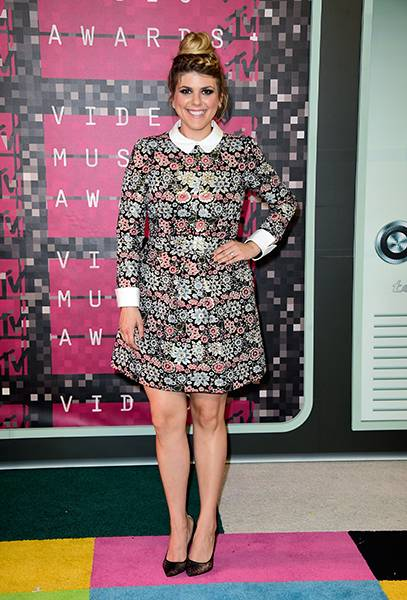 Molly Tarlov takes a break from her 'Awkward' cheerleading uniform and stuns in a floral Peter Pan frock.