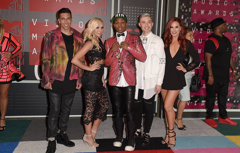 New to the MTV family, Todrick Hall goes for leather pant and colorful suit jacket combo on the 2015 VMA carpet.