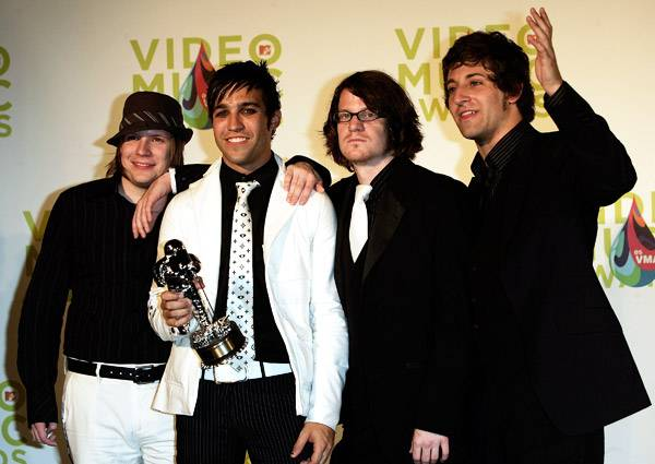 The guys of Fall Out Boy say hello to their first ever Moonman at the 2005 Video Music Awards.