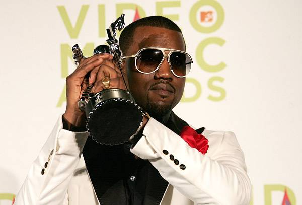 Kanye West grips his Moonman with the classic stance a of a champion after winning the Best Male Video Award in 2005.