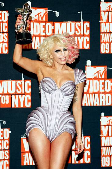 Lady Gaga matches her space-age outfit to the Moonman's own astronaut duds at the 2009 Video Music Awards.