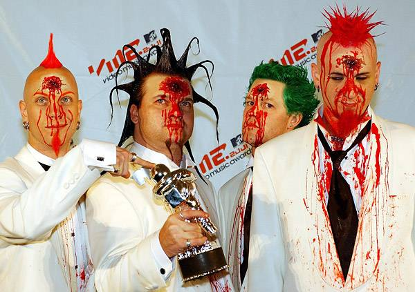 Heavy-metal rockers Mudvayne take care not to splatter any red goo on their 2001 Moonman.