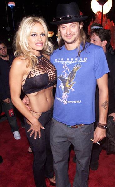 09.06.2001, New York City, NY: Pamela Anderson stole the spotlight in this busty number when she and then boyfriend Kid Rock stepped out on the carpet at the 2001 VMAs.