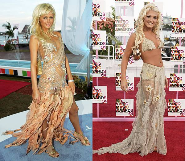 Blonde bombshells Paris Hilton and Brooke Hogan opt for barely-there mermaid dresses at the 2004 VMAs.