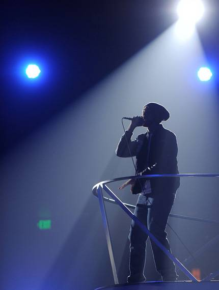 """Travie McCoy performs """"Billionaire"""" on stage with House Artist deadmau5 during the 2010 MTV Video Music Awards."""