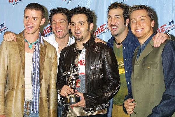 Former American boy band *NSYNC is all smiles after scoring four wins at the 2001 MTV VMAs.