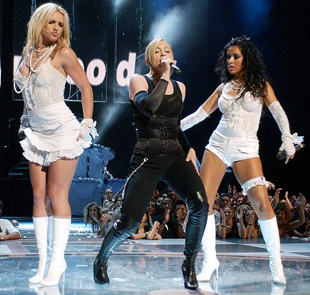 08.28.2003, New York City, NY: Britney Spears and Christina Aguilera still have us talking after they performed wearing barely there all-white lace numbers alongside a leather-clad Madonna at the 2003 Video Music Awards.
