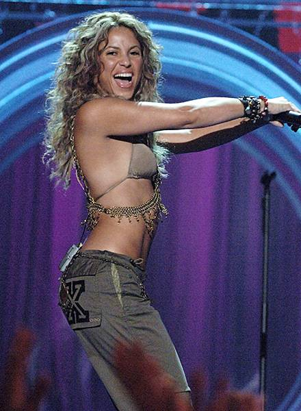 08.28.2005, Miami, FL: Shakira happily delivers a hip shaking performance while showing off her perfectly sculpted bod at the 2005 Video Music Awards.
