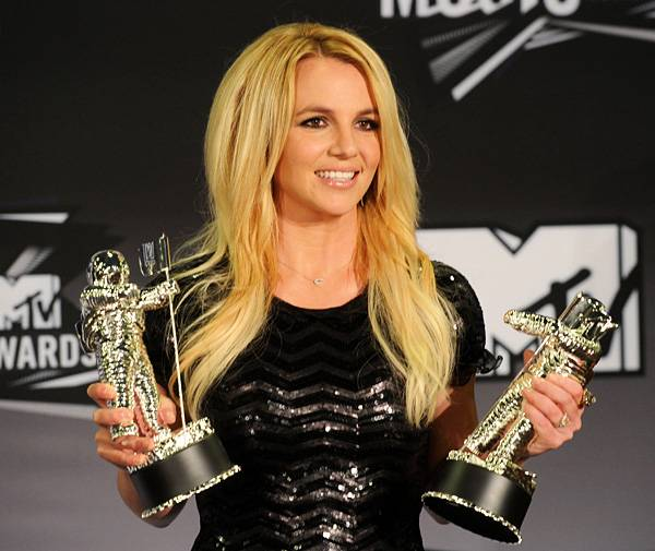 Make room on your trophy shelf, Britney! The Princess of Pop proudly displays Moonmen numbers 5 and 6 after receiving Video Vanguard and Best Pop Video honors at the 2011 MTV Video Music Awards.