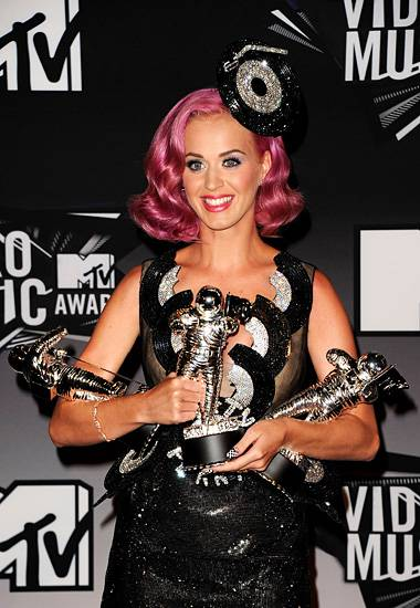 Always dressed for the occasion, a sparkly Katy Perry accessorizes with an armful of not-to-be-outshined Moonmen in 2011.