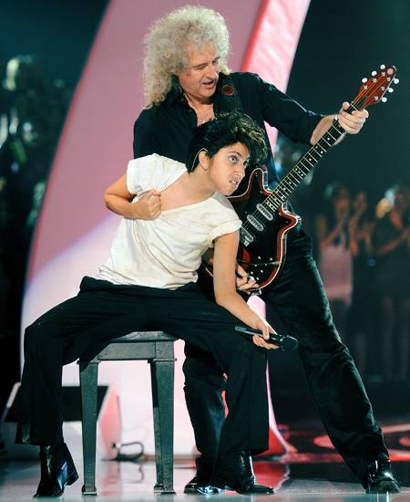 """Lady Gaga (as alter-ego Jo Calderone) and Queen guitarist Brian May perform """"Yoü and I"""" on stage at the 2011 MTV Video Music Awards in Los Angeles."""