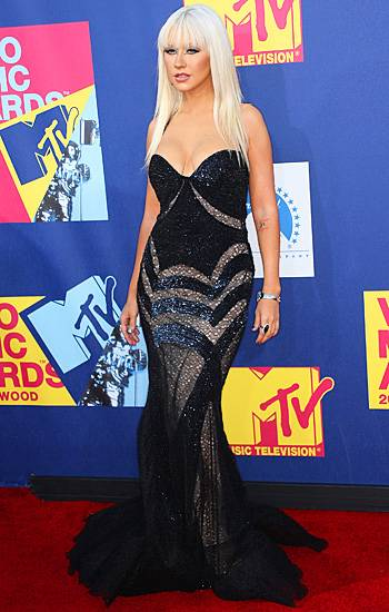 A very glamorous Christina Aguilera goes glam with thick black eyeliner and a sparkling black gown at the 2008 VMAs.