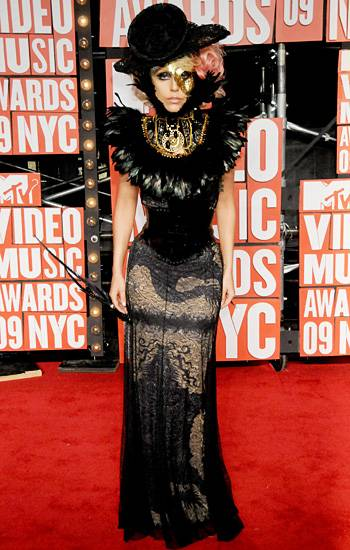 Lady Gaga would never allow black to be boring! Her corset dress, feathers, and hat keep the monotone ensemble super interesting at the 2009 VMAs.