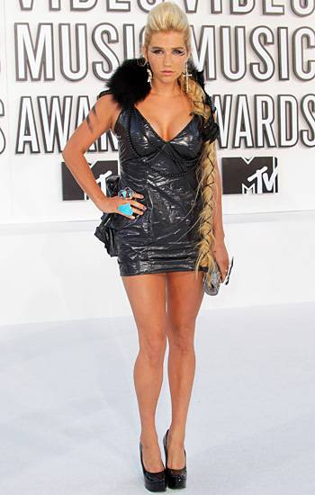 Ke$ha lets her wild side run free in a black mini dress (made from a trash bag!) with a fur-lined collar at the 2010 VMAs.