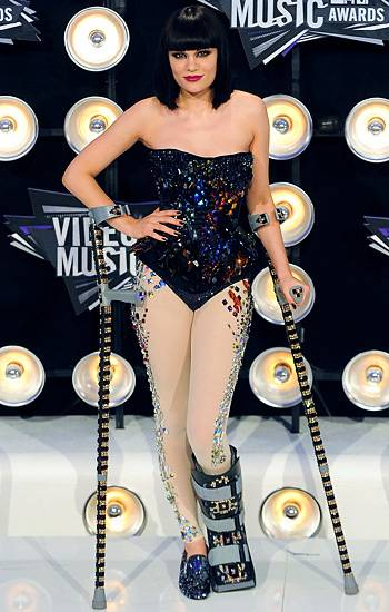 Even with a broken foot, Jessie J knows how to bring the fierceness! Here, the singer rocks a shimmering black body suit with jewels that stretch all the way down to her boot on the 2011 VMA red carpet.
