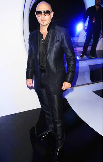 Rapper Pitbull puts black-on-black-on-black with his sophisticated suit, shoes, and sunglasses on the 2011 VMA red carpet.