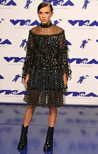 'Stranger Things' star Millie Bobby Brown looked all grown up with sleek hair and a chic black dress that showed off her amazing fashion sense on the 2017 VMA red carpet.