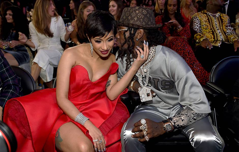 Migos member and VMA nominee Offset whispered sweet nothings into his wife, Cardi B's ear at the 2018 Video Music Awards in New York City.